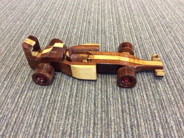 A F1 car made from wood scraps