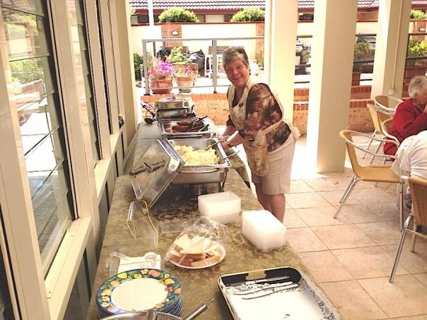 Carol organising the serving area..