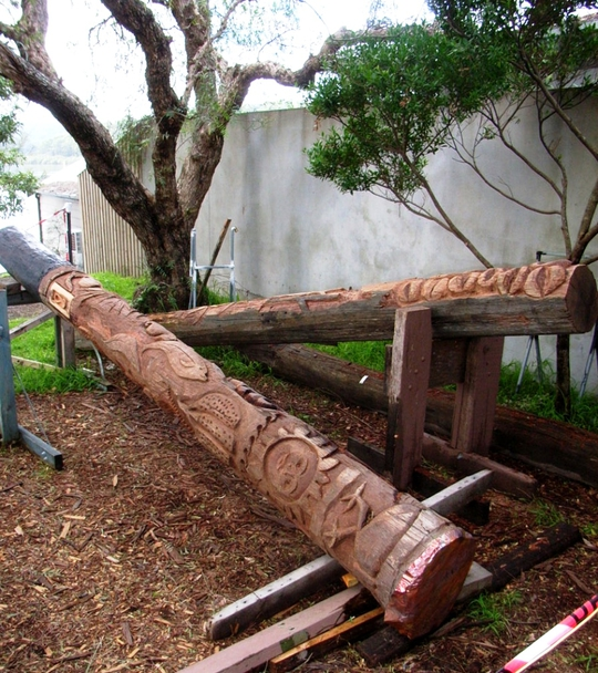 Used telegraph poles being carved in May 2013